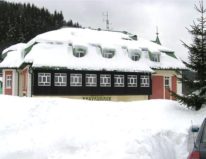 Zasněžený dům s krytinou Prefa