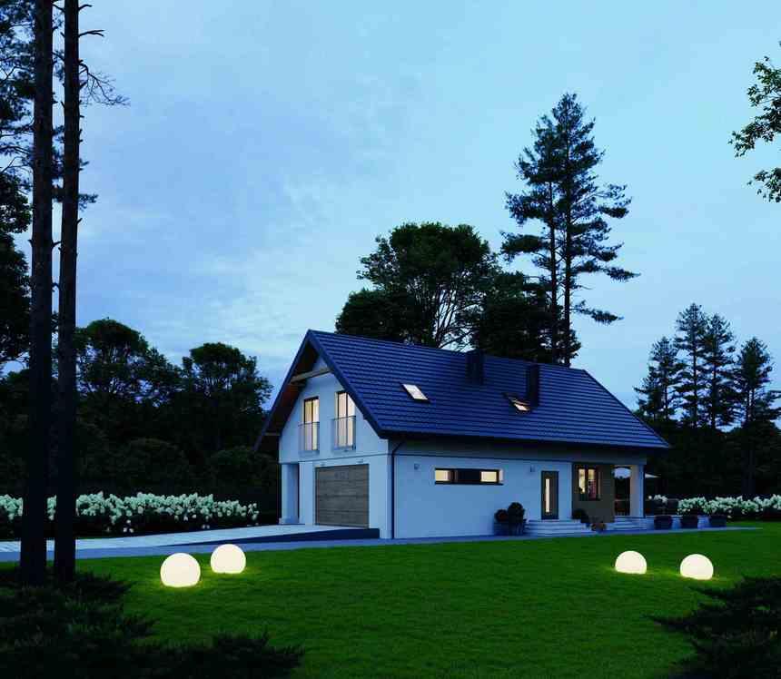Osvětlený dům v noci s krytinou Ruukki Frigge