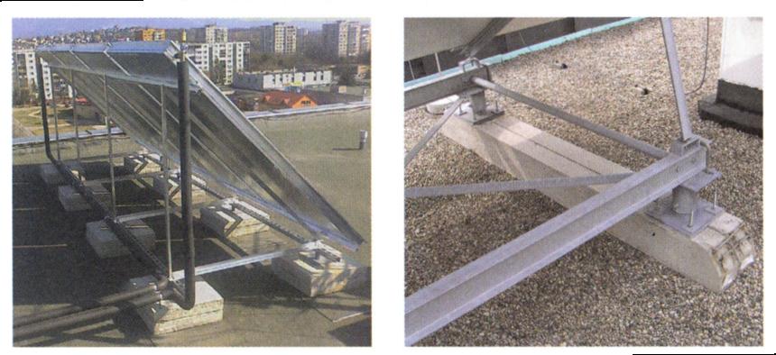 Volně položené zátěžové betonové bloky na ploché střeše