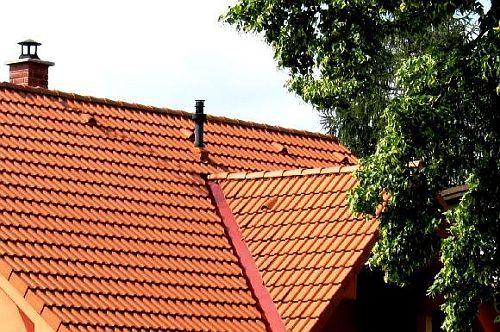 KM Beta, střecha s taškou od kouření