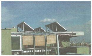 Grada, Kolektorové pole na střeše bytového domu, zdroj Regulus