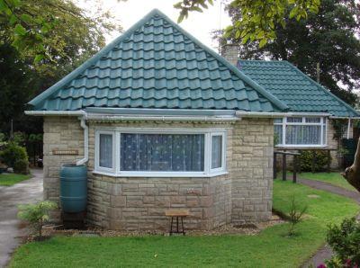 Střecha po provedení nátěru betonových tašek